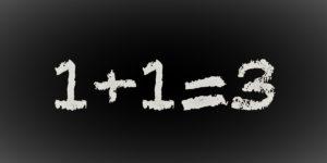 Pizarra con suma 1 + 1 = 3