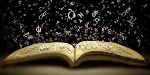 libro abierto con letras en el aire